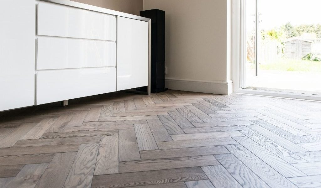 """Owner Mac explained, """"We liked our parquet wood floors, but the damaged floor, having been installed many years ago was no longer available with Rose Wood ..."""