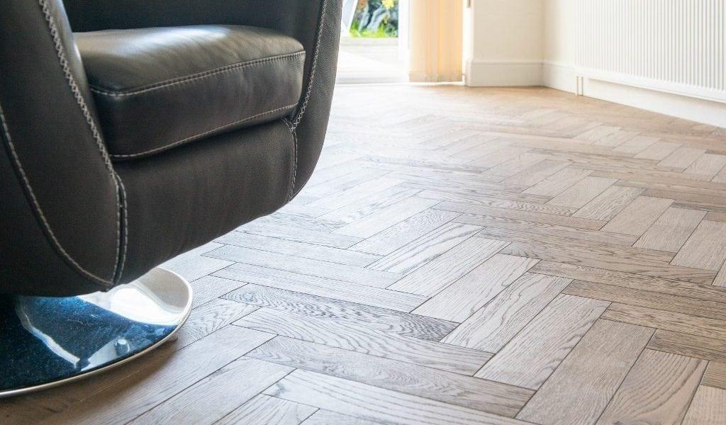 Zigzag engineered wood blocks bring modern parquet styling to this Essex home