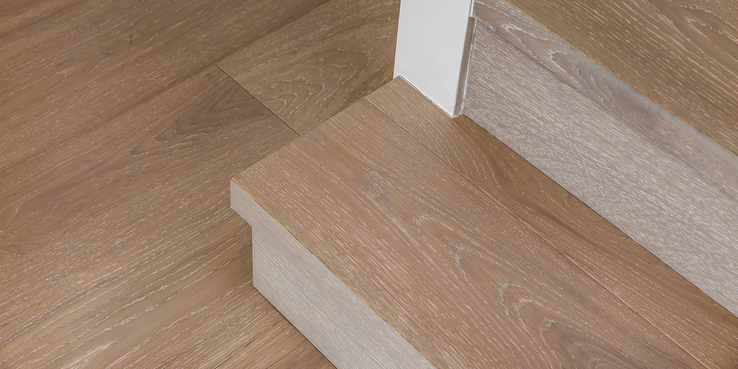 V4's Alpine Lock in Silver Sands wood floors complete this