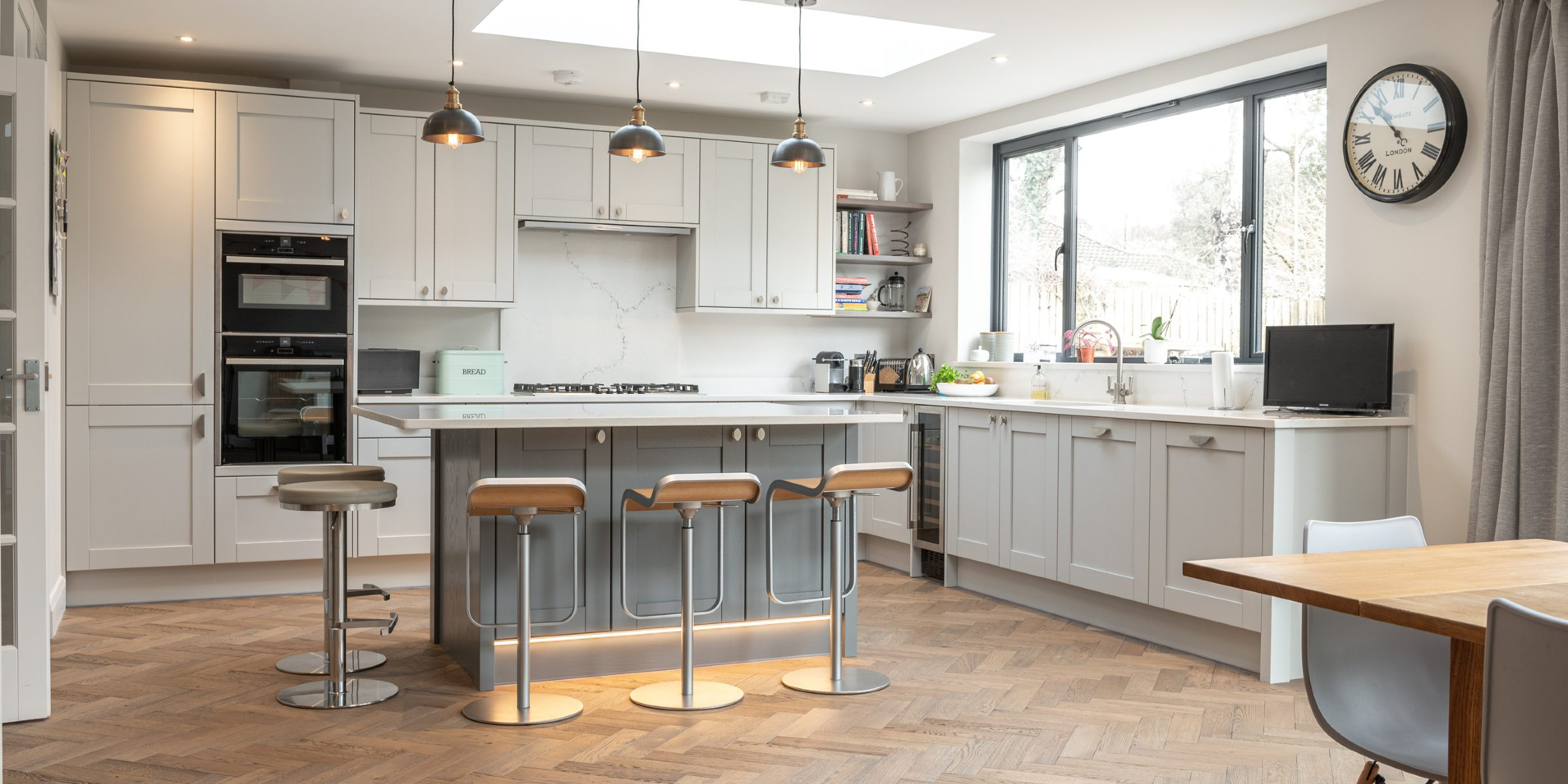 howdens kitchen with herringbone flooring